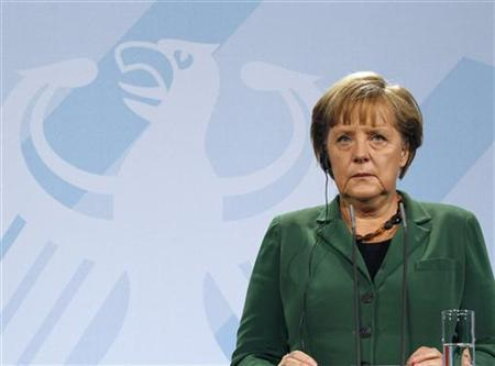 German Chancellor Angela Merkel listens to a journalist's question as she addresses a news conference with French President Nicolas Sarkozy (not pictured) at the Chancellery in Berlin October 9, 2011. REUTERS/Fabrizio Bensch