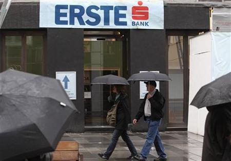 People pass the Erste Group Bank headquarters which is currently under refurbishment in Vienna, October 10, 2011. REUTERS/Heinz-Peter Bader