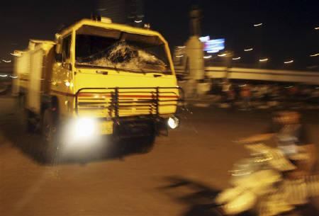 A riot police vehicle advances towards Egyptian Christians during a protest against an attack on a church in southern Egypt, in Cairo October 9, 2011. REUTERS/Amr Abdallah Dalsh