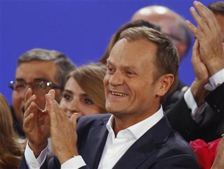 Poland's Prime Minister Donald Tusk reacts after the election results announcement in Warsaw October 9, 2011.  REUTERS/Peter Andrews