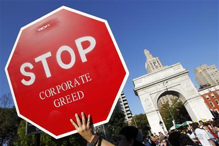A protester holds a sign during an ''Occupy Wall Street'' rally in New York's Washington Square October 8, 2011.  REUTERS/Jessica Rinaldi