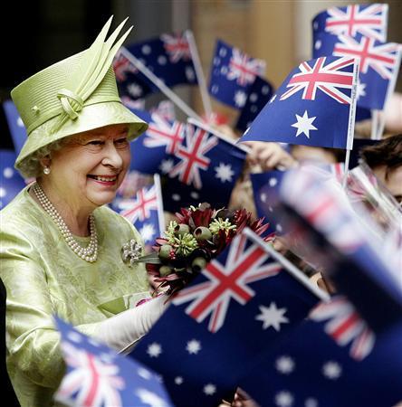 Britain's Queen Elizabeth receives flowers from schoolchildren waving Australian flags in Sydney in this March 13, 2006 file photo.REUTERS/Stringer/Files