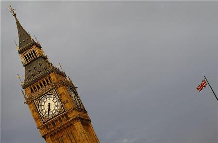 An Union flag is seen fluttering next to the Big Ben in London April 27, 2011. REUTERS/Kai Pfaffenbach