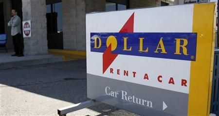 A Dollar rent-a-car return sign is seen on a lot near the Detroit Metropolitan airport in Romulus, Michigan, May 9, 2011. HREUTERS/Rebecca Cook