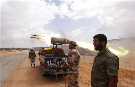Anti-Gaddafi fighters fire C5 rockets during clashes with pro-Gaddafi forces at the front line in Sirte October 11, 2011. REUTERS/Saad Shalash