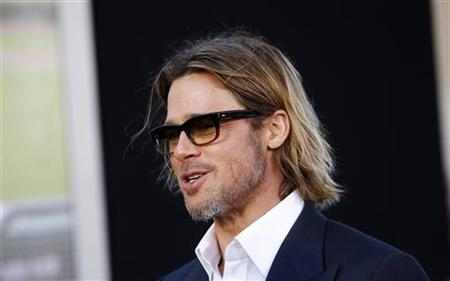 U.S. actor Brad Pitt, who stars as Oakland Athletics' general manager Billy Beane, arrives for the world premiere of the film ''Moneyball'' in Oakland, California September 19, 2011. REUTERS/Robert Galbraith
