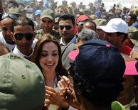 United Nations High Commissioner for Refugees (UNHCR) goodwill ambassador Angelina Jolie visits Shousha Camp near the Tunis-Libyan border, April 5, 2011.            REUTERS/Anis Mili