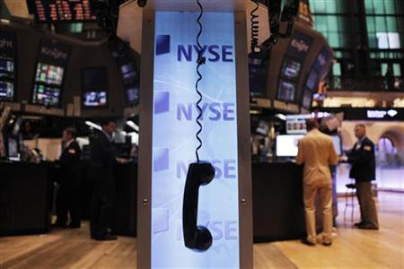 A phone hangs above the floor of the New York Stock Exchange shortly after the opening of the market August 19, 2011.  REUTERS/Lucas Jackson