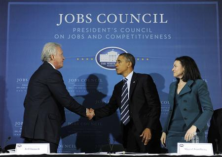 President Obama shakes hands with council chairman, General Electric CEO Jeffrey Immelt, after a meeting of the President's Council on Jobs and Competitiveness in Pittsburgh, October 11, 2011. Also pictured is Facebook COO Sheryl Sandberg. REUTERS/Jonathan Ernst