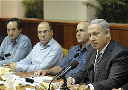 Israel's Prime Minister Benjamin Netanyahu (R) speaks during a special cabinet meeting at his office in Jerusalem October 11, 2011, in this picture released by the Israeli Government Press Office (GPO). REUTERS/Avi Ohayon/GPO/Handout