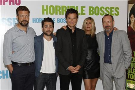 Actors (L-R) Jason Sudeikis, Charlie Day, Jason Bateman, Jennifer Aniston and Kevin Spacey pose during a media event to promote their latest movie ''Horrible Bosses'', at a hotel in London July 20, 2011.   REUTERS/Stefan Wermuth