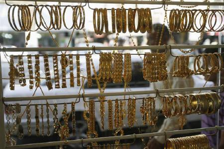 A Palestinian man walks past a jewellery shop in the West Bank city of Jenin October 10, 2009. REUTERS/Mohamad Torokman/Files