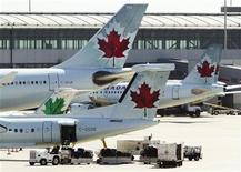<p>Air Canada aircraft are seen at Toronto Pearson International Airport, September 20, 2011. REUTERS/Mark Blinch</p>