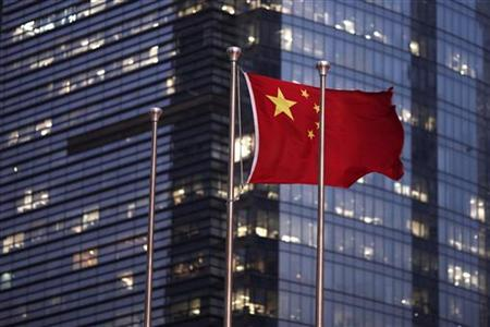 The Chinese national flag is seen in the financial district of Pudong in Shanghai September 22, 2011. REUTERS/Carlos Barria