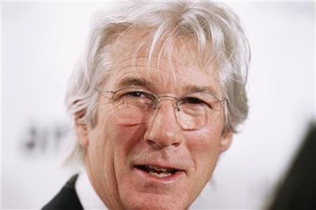 Actor Richard Gere arrives to attend the amfAR New York Gala which begins Fall 2011 Fashion Week in New York February 9, 2011. REUTERS/Lucas Jackson
