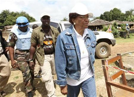 Nobel Peace Prize Laureate Ellen Johnson-Sirleaf, who is also Liberia's president and presidential candidate of the Unity Party (UP), arrives to vote at the polling station in Feefee in Bomi County October 11, 2011.  REUTERS/Luc Gnago