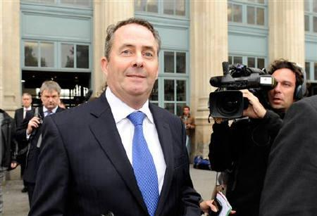 Britain's Defence Secretary Liam Fox arrives at the Paris Gare du Nord station via a Eurostar train to attend a meeting in Paris October 12, 2011.  REUTERS/Gonzalo Fuentes