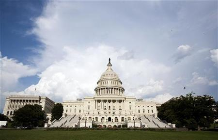 Clouds pass over Capitol Hill in Washington August 1, 2011.  REUTERS/Joshua Roberts