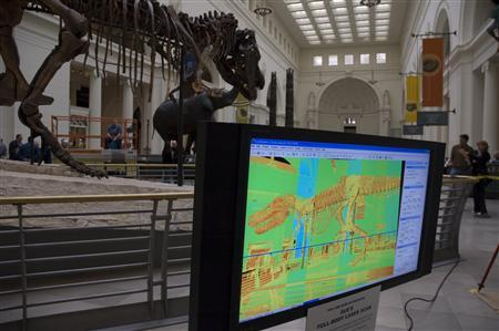 Visitors watch a full body scan of a Tyrannosaurus rex skeleton nicknamed ''Sue''. REUTERS/Handout/The Field Museum