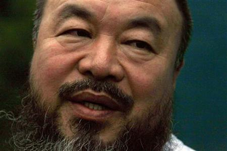 Dissident Chinese artist Ai Weiwei speaks to members of the media in the doorway of his studio after he was released on bail in Beijing June 23, 2011. REUTERS/David Gray