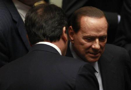 Italian Minister of Agriculture Francesco Saverio Romano (L) talks with Prime Minister Silvio Berlusconi during a debate at the lower house of parliament in Rome September 28, 2011. REUTERS/Tony Gentile