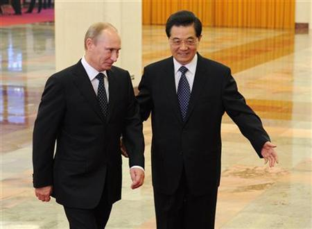 Chinese President Hu Jintao (R) and Russian Prime Minister Vladimir Putin walk ahead of their talks at the Great Hall of the People in Beijing October 12, 2011. REUTERS/Takuro Yabe/Pool