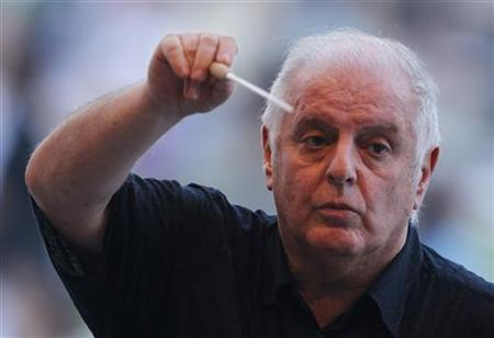 Israeli-Argentine conductor Daniel Barenboim directs the West-Eastern Divan orchestra, which includes Arab and Israeli musicians, during a rehearsal before the Barenboim Peace concert wishing peace on the Korean Peninsula at Imjingak pavilion, near the demilitarized zone separating the two Koreas in Paju, about 55 km (34 miles) north of Seoul, August 15, 2011. REUTERS/Jo Yong-Hak