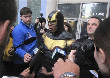 Benjamin Fodor, aka Seattle superhero ''Phoenix Jones'', speaks to the media after making a court appearance in Seattle, Washington, October 13, 2011. REUTERS/Nicole Neroulias