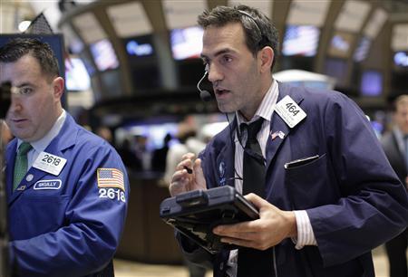 Traders work on the floor of the New York Stock Exchange October 12, 2011.     REUTERS/Brendan McDermid