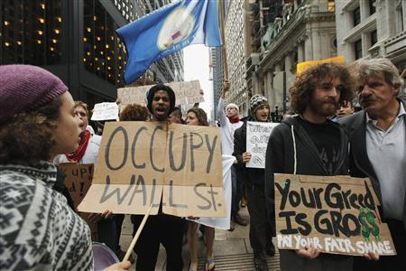 Members of the Occupy Wall Street movement take part in a protest march through the financial district of New York, October 12, 2011. REUTERS/Lucas Jackson