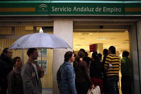 People wait in line to enter a government job centre in Malaga, southern Spain, April 29, 2011. REUTERS/Jon Nazca
