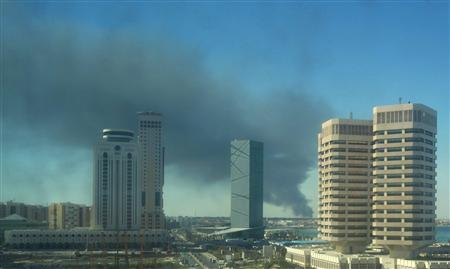 Smoke rises over the western side of Tripoli, October 14, 2011. REUTERS/Suhaib Salem