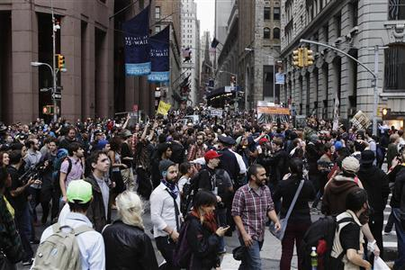Members of the Occupy Wall Street movement march down Wall Street during a protest march through the financial district of New York October 14, 2011.  REUTERS/Lucas Jackson