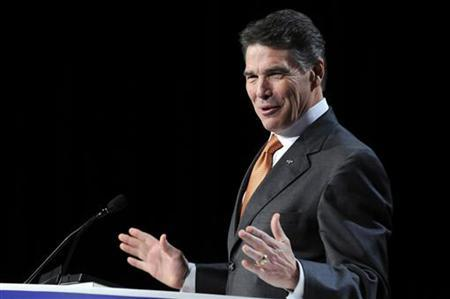 Republican presidential candidate Governor Rick Perry (R-TX) takes the stage to address the Family Research Council's Values Voters Summit in Washington October 7, 2011.  REUTERS/Jonathan Ernst