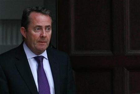Britain's Defence Secretary Liam Fox leaves his residence in central London October 13, 2011. REUTERS/Suzanne Plunkett