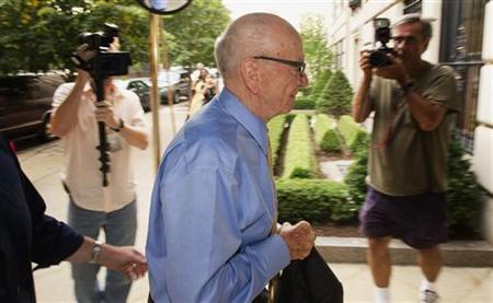 News Corporation Chairman and Chief Executive Rupert Murdoch (C) arrives at his home in New York July 20, 2011.  REUTERS/Lucas Jackson