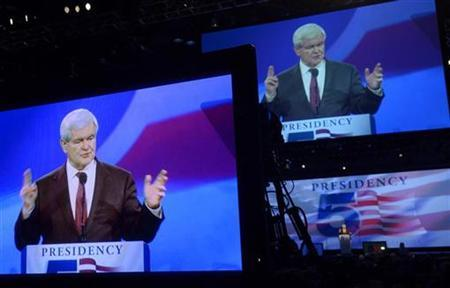 Former U.S. House of Representatives Speaker Newt Gingrich is projected onto monitors at the Orange County Convention Center as he speaks to delegates during the Republican Party of Florida Presidency 5 Convention in Orlando, Florida September 24, 2011. REUTERS/Phelan Ebenhack