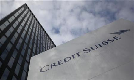 A logo is seen in front of a Credit Suisse building in Zurich, July 28, 2011.  REUTERS/Christian Hartmann