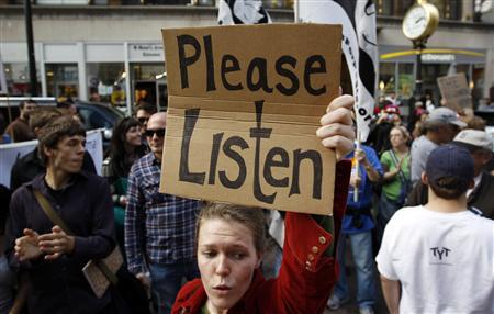 Occupy Boston protestors join an anti-war march through Boston, Massachusetts October 15, 2011. REUTERS/Brian Snyder