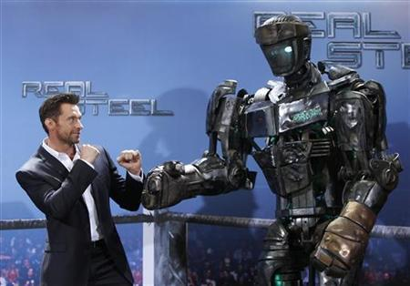 Australian actor Hugh Jackman poses during a photocall in Munich September 12, 2011 to promote the film ''Real Steel''. The movie will premiere in Germany on November 10, 2011. REUTERS/Michaela Rehle