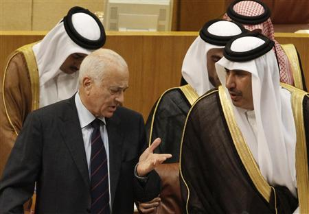 Arab League Chief Nabil Elaraby (L) speaks with Qatar's Prime Minister and Foreign Minister Sheikh Hamad bin Jassim al-Thani during the opening meeting of Arab League foreign ministers to discuss Syria at the League headquarters in Cairo October 16, 2011. REUTERS/Mohamed Abd El-Ghany