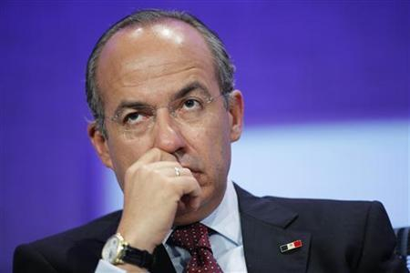 Mexico's President Felipe Calderon listens during a discussion on climate change at the Clinton Global Initiative in New York, September 20, 2011. REUTERS/Lucas Jackson