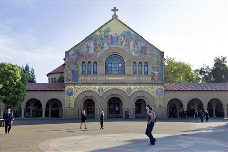 People walk in front of a church on the campus of Stanford University in Palo Alto, California, October 16, 2011. Apple Inc co-founder and technology visionary Steve Jobs will be memorialized at a private service at Stanford University on Sunday, a source with knowledge of the event said.   REUTERS/Kimberly White