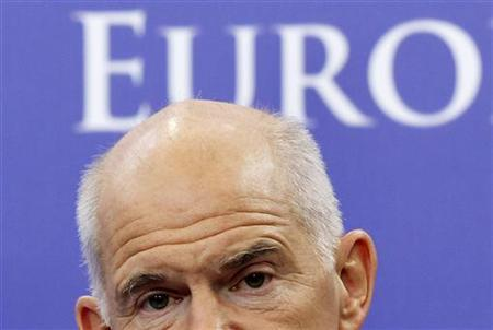 Greece's Prime Minister George Papandreou briefs the media after a meeting with European Council President Herman Van Rompuy in Brussels, October 13, 2011. REUTERS/Thierry Roge