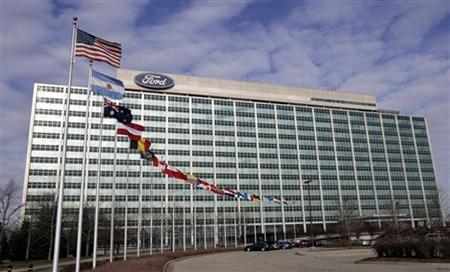 International flags fly alongside the U.S. flag (front) in front of the Ford Motor headquarters in Dearborn, Michigan December 16, 2009.  REUTERS/Rebecca Cook
