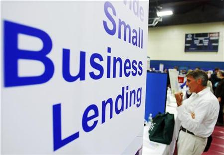 Current and prospective small business owners talk to vendors with information about state, federal, and private funding resources at a Small Business Financing Fair in Manchester, New Hampshire June 29, 2009.   REUTERS/Brian Snyder