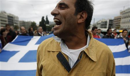 A man shouts slogans during a rally of the ''Indignant'' group in front of the parliament in Athens October 15, 2011. REUTERS/Yiorgos karahalis