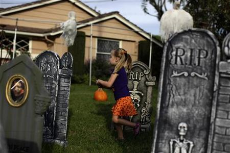 Cadence Cirlin, 3, plays in the garden of a home decorated for Halloween in Los Angeles, California, October 29, 2010. REUTERS/Lucy Nicholson