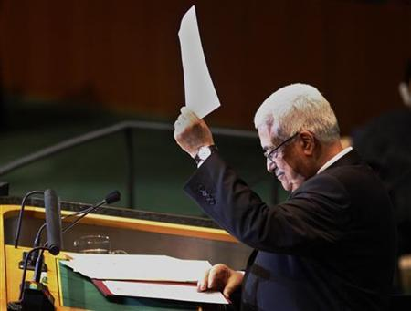 Palestinian Authority president Mahmoud Abbas holds up a letter to United Nations Secretary General Ban Ki-Moon requesting Palestinian statehood at the 66th United Nations General Assembly at U.N. headquarters in New York September 23, 2011. REUTERS/Eric Thayer