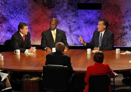 Republican presidential hopefuls (L-R) Texas Gov. Rick Perry, businessman Herman Cain, and former Massachusetts Governor Mitt Romney participate in a Republican presidential debate at Dartmouth College in Hanover, New Hampshire October 11, 2011. REUTERS/Adam Hunger